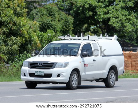 CHIANGMAI , THAILAND -JUNE 29 2015 :    Pickup  truck of True company. Intenet Service in Thailand. Photo at road no 121 about 8 km from downtown Chiangmai, thailand. - stock photo