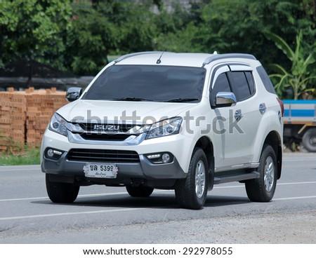 CHIANGMAI , THAILAND -JUNE 30 2015: Private car, Isuzu Mu-X. Photo at road no 121 about 8 km from downtown Chiangmai, thailand. - stock photo