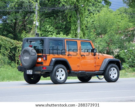CHIANGMAI , THAILAND -JUNE 11 2015:  Private jeep car. Photo at road no.121 about 8 km from downtown Chiangmai, thailand. - stock photo