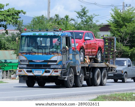 CHIANGMAI , THAILAND -JUNE 19  2015: Private trailer truck for car move. Photo at road no.121 about 8 km from downtown Chiangmai, thailand.