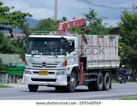 CHIANGMAI , THAILAND -JUNE 22 2015:  Truck with Crane Satapornnirattisai transport Company. Photo at road no 1001 about 8 km from downtown Chiangmai, thailand. - stock photo