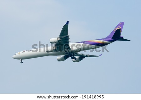 CHIANGMAI , THAILAND - MARCH 28 2009: HS-TNA  Airbus A340-600 of Thaiairway. Landing to Chiangmai airport from Bangkok Suvarnabhumi.