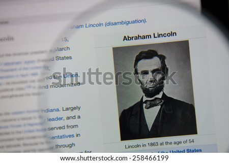CHIANGMAI, THAILAND - March 5, 2015: Photo of Wikipedia article page of Abraham Lincoln on a ipad monitor screen through a magnifying glass. - stock photo