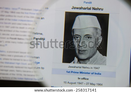 CHIANGMAI, THAILAND - March 5, 2015: Photo of Wikipedia article page of Jawaharlal Nehru on a ipad monitor screen through a magnifying glass. - stock photo