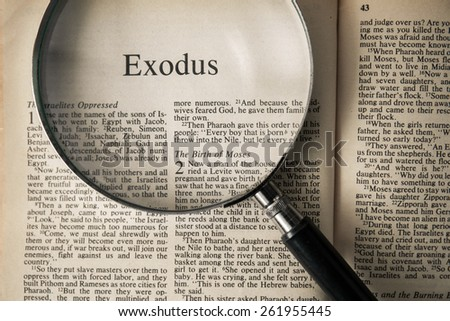 "CHIANGMAI, THAILAND, March 17,2015. Reading The New International Version of the Holy Bible on the book of "" exodus "" at home. March 17,2015"