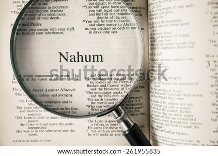 "CHIANGMAI, THAILAND, March 17,2015. Reading The New International Version of the Holy Bible on the book of "" nahum "" at home. March 17,2015"