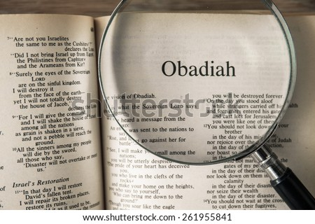 "CHIANGMAI, THAILAND, March 17,2015. Reading The New International Version of the Holy Bible on the book of "" obadiah "" at home. March 17,2015"
