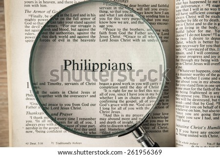 "CHIANGMAI, THAILAND, March 17,2015. Reading The New International Version of the Holy Bible on the book of "" phillippians "" at home. March 17,2015"