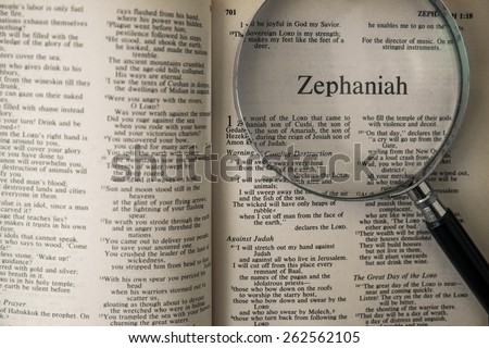 "CHIANGMAI, THAILAND, March 22,2015. Reading The New International Version of the Holy Bible on the book of "" zephaniah "" at home. March 22,2015"