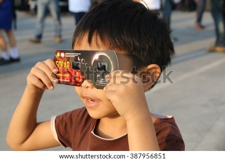 Chiangmai, Thailand - March 9, 2016: Thailand boy viewing a solar eclipse in Chiang Mai, Thailand.