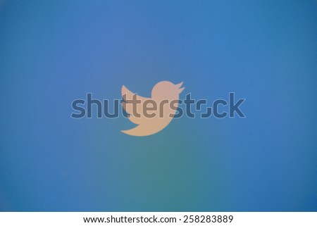 "CHIANGMAI, THAILAND - MARCH 6, 2015: Twitter is an online social networking and microblogging service that enables users to send and read ""tweets"", limited to 140 characters. - stock photo"