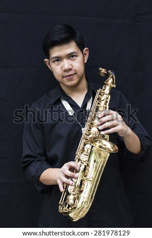 CHIANGMAI, THAILAND - MAY 28, 2015.  image of a handsome young man  holding his  selmer saxophone made  in France by selmer company at In  Grace Church Chiangmai, Thailand  - stock photo