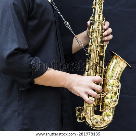 CHIANGMAI, THAILAND - MAY 28, 2015.  image of a young man  playing  alto saxophone made  in France by selmer company at In  Grace Church Chiangmai, Thailand  - stock photo