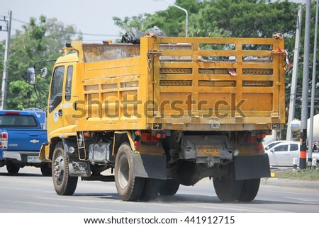 CHIANGMAI, THAILAND -MAY 27 2016: Yellow Isuzu  Dump Truck of CRC Company. Photo at road no 121 about 8 km from downtown Chiangmai, thailand.