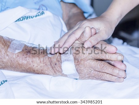 CHIANGMAI, THAILAND - November 24,2015.  image of praying of visitor and patient hands at Mccormick hospital, Chiangmai, Thailand - stock photo