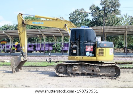 CHIANGMAI, THAILAND - NOVEMBER 15 2013: Private backhoe work for change railroad sleeper from wood to concrete. Work of State railway of thailand.  Photo at Chiangmai Train Station,  Thailand.   - stock photo