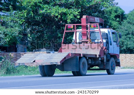 CHIANGMAI, THAILAND - NOVEMBER 1 2014:  Private Truck with crane. Photo at road no.121 about 8 km from downtown Chiangmai, thailand.