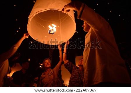 CHIANGMAI, THAILAND - NOVEMBER 16 :Thai people floating lamp. November 16 ,2013 in Tudongkasatarn, Chiangmai, Thailand. Tudongkasatarn is where floating lamp ceremony takes place every year. - stock photo