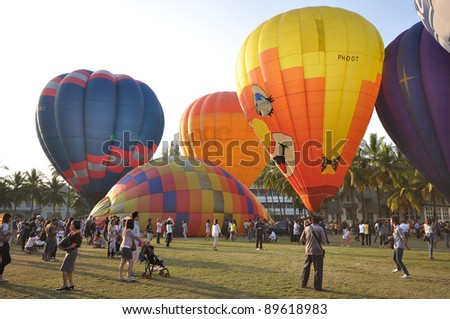 CHIANGMAI THAILAND-NOVEMBER 26 :Thailand International Balloon Festival in Chiangmai.People come to watch the release of balloons in the evening. on November 26,2011 in Chiangmai,Thailand