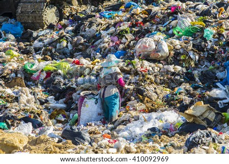 Chiangmai, THAILAND - November 4, 2015: Woman workers in the large landfill at Hod district, Chiangmai province.