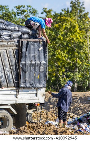Chiangmai, THAILAND - November 4, 2015: Workers in the large landfill at Hod district, Chiangmai province.