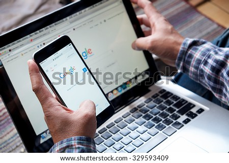 CHIANGMAI, THAILAND -OCT 20, 2015:A man touch on screen new Apple iPhone 6 Plus smartphone device open google application. - stock photo