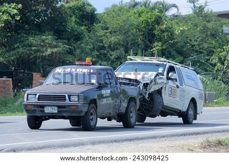 CHIANGMAI, THAILAND - OCTOBER 31 2014:   NMS Tow truck for emergency car move. Photo at road no 121 about 8 km from downtown Chiangmai, thailand. - stock photo