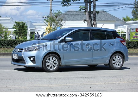 CHIANGMAI, THAILAND -OCTOBER  15 2015:   Private car toyota Yaris. Photo at road no 121 about 8 km from downtown Chiangmai, thailand.