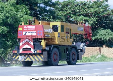 CHIANGMAI, THAILAND -OCTOBER 25 2014:  TADANO Crane Truck of CJ Crane Company. Photo at road no 121 about 8 km from downtown Chiangmai, thailand. - stock photo