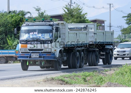 CHIANGMAI, THAILAND - OCTOBER 31 2014:   Trailer dump truck. Photo at road no.121 about 8 km from downtown Chiangmai, thailand.