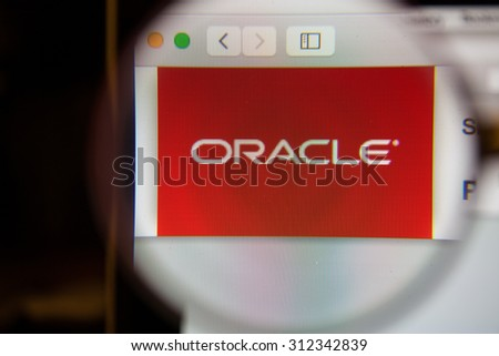 CHIANGMAI, THAILAND - September 1, 2015:Photo of Oracle homepage on a monitor screen through a magnifying glass.