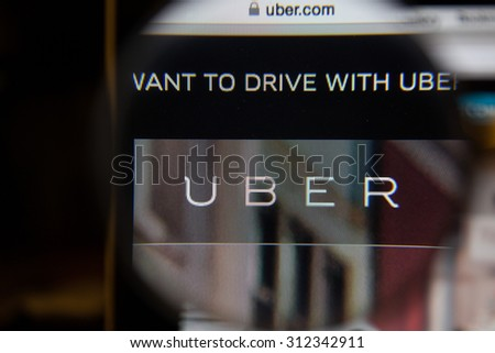 CHIANGMAI, THAILAND - September 1, 2015:Photo of: www.uber.com, uber homepage on a monitor screen through a magnifying glass. - stock photo