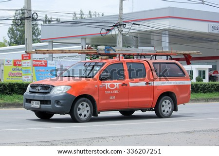 CHIANGMAI, THAILAND -SEPTEMBER  10 2015:  Pickup truck of Tot company.Intenet and Telephone Service in Thailand. Photo at road no.121 about 8 km from downtown Chiangmai, thailand. - stock photo