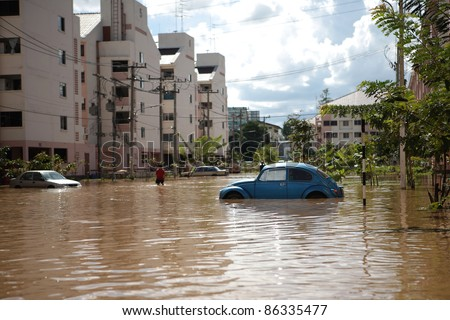 CHIANGMAI , THAILAND - SEPTEMBER 29 : Thai monsoon Cars in water flooded streets on September 30, 2011 in Nonghoi , Muang , Chiangmai , Thailand. - stock photo