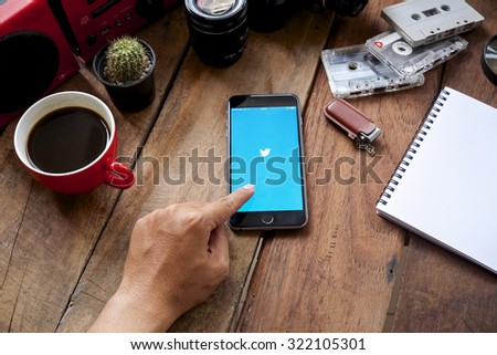 """CHIANGMAI, THAILAND -SPE 30, 2015:Twitter is an online social networking and microblogging service that enables users to send and read """"tweets"""" - stock photo"""