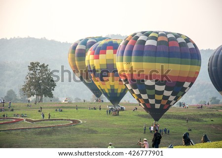 CHIANGRAI, THAILAND - FEBRUARY 14, 2016 : Hot air Balloons ready to rise into the sky in the morning at SINGHA PARK CHIANGRAI BALLOON FIESTA 2016, Chiangrai province, Thailand