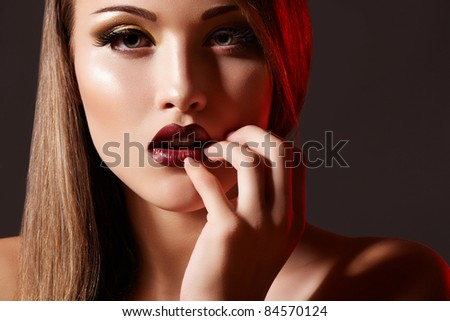 Chic evening style. Alluring woman model with luxury fashion make-up, dark red lips makeup and long hair - stock photo