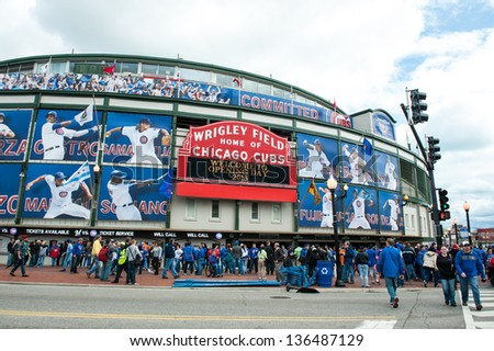 CHICAGO - APRIL 8: Chicago Cubs fans gather at Wrigley Field in Chicago for the 2013 Major League Baseball home opener on April 8, 2013. - stock photo