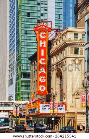 CHICAGO - APRIL 9: Chicago Theather with people on April 09, 2014 in Chicago, IL. It'is a landmark theater located on North State Street in the Loop area of Chicago. - stock photo