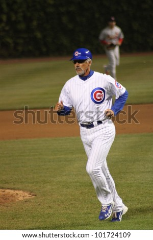 CHICAGO - APRIL 25: Dave Mckay of the Chicago Cubs is the first base coach against the St. Louis Cardinals at Wrigley Field on April 25, 2012 in Chicago, Illinois. - stock photo