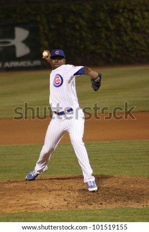 CHICAGO - APRIL 25: Rafael Dolis of the Chicago Cubs pitches during a game against the St. Louis Cardinals  at Wrigley Field on April 25, 2012 in Chicago, Illinois. - stock photo