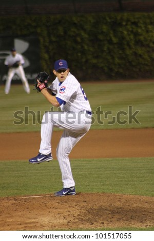 CHICAGO - APRIL 25: Shawn Camp of the Chicago Cubs pitches against the St. Louis Cardinals at Wrigley Field on April 25, 2012 in Chicago, Illinois. - stock photo