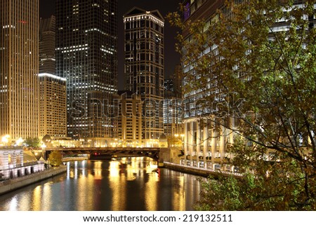 Chicago at night looking west up the Chicago River from Michigan Avenue. - stock photo