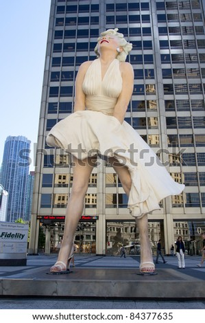 CHICAGO - AUG 25: A giant 26 foot tall sculpture of Marilyn Monroe stands in a square on Michigan Avenue in Chicago on August 25, 2011. The work was created by artist Seward Johnson. - stock photo