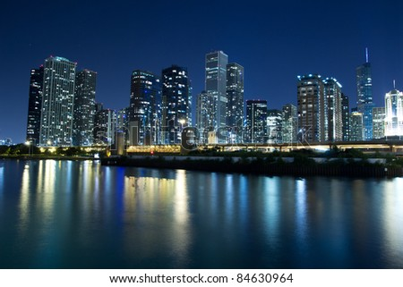 CHICAGO - AUG 26: The Chicago Skyline at night on August 26, 2011 in Chicago. The Chicago's skyline is one of the world's tallest with three of America's five tallest buildings. - stock photo