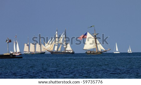 CHICAGO - AUGUST 24:  Chicago welcomes more than 20 historic tall ships from around the world for a festival August 24, 2010 in Chicago. The ships will be berthed at Navy Pier for viewing. - stock photo