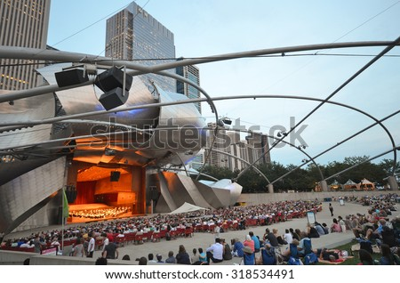 Chicago - August 14: Evening concert performance at the Jay Pritzker Pavilion in Chicago, USA, on August 14, 2015. The Pavilion, designed by Frank Gehry, is an outdoor performing arts venue. - stock photo