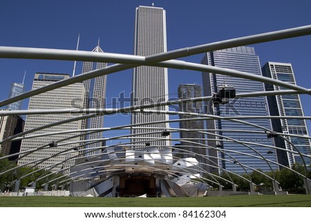 CHICAGO - AUGUST 25: The Jay Pritzker Pavilion in Chicago on August 25, 2011. The 11,000 capacity pavilion includes 4,000 fixed seats and a 95,000-square-foot (8,800 m2) grass lawn. - stock photo