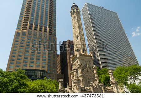 Chicago Avenue Water Tower and Pumping Station with downtown in background.  Chicago, Illinois, U.S.A.. - stock photo
