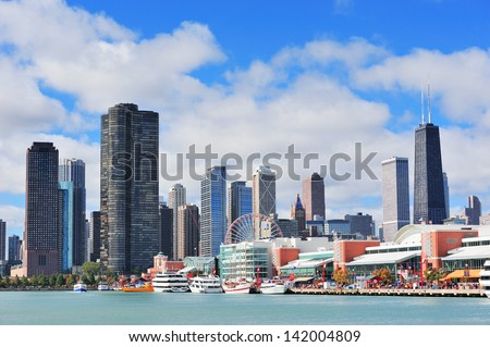 Chicago city downtown urban skyline with skyscrapers over Lake Michigan with cloudy blue sky. - stock photo
